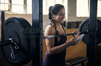 Buy stock photo Cropped shot of an attractive young woman working out in the gym