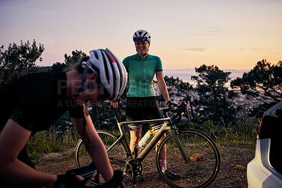 Buy stock photo Shot of two sporty young women out cycling