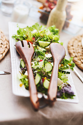 Buy stock photo High angle shot of a scrumptious salad on a plate on a table outdoors