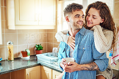 Buy stock photo Cropped shot of an affectionate couple spending time together at home