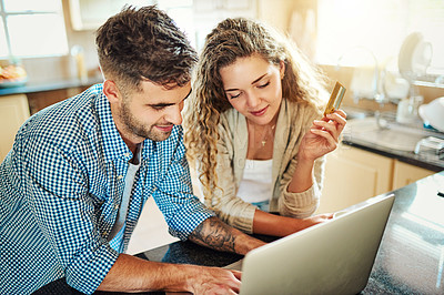 Buy stock photo Cropped shot of a young couple using a laptop together at home