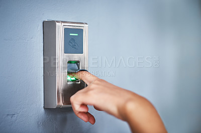 Buy stock photo Shot of an unrecognizable woman using a fingerprint scanner to enter a building