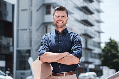Buy stock photo Portrait of a handsome mature businessman standing outside in the city