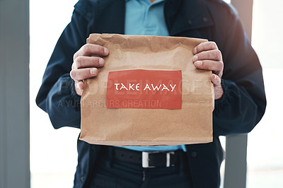 Buy stock photo Shot of an unrecognizable delivery man holding a restaurant takeaway