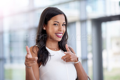 Buy stock photo Shot of a young businesswoman pointing at you in a modern office