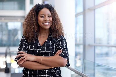 Buy stock photo Cropped portrait of an attractive young businessman standing with her arms crossed in the office