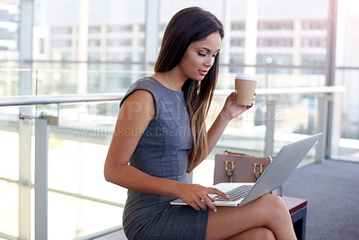Buy stock photo High angle shot of an attractive young businesswomen working on her laptop in the office