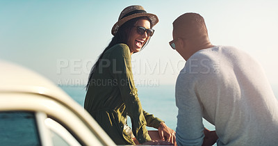 Buy stock photo Cropped shot of a young couple making a stop at the beach while out on a road trip