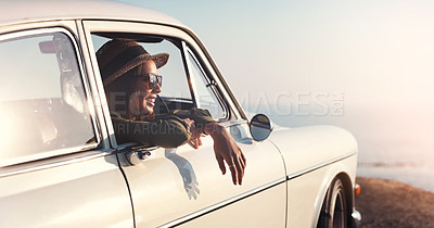 Buy stock photo Cropped shot of a young woman looking out her car window while out on a road trip