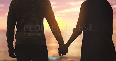 Buy stock photo Rearview shot of an unrecognizable affectionate couple holding hands at sunset on the beach