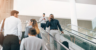 Buy stock photo Cropped shot of businesspeople passing each other on the escalators in the workplace
