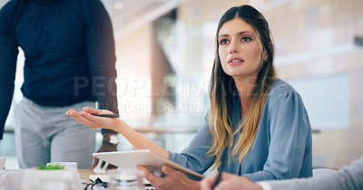 Buy stock photo Cropped shot of a businesswoman discussing with her colleagues during a meeting in the boardroom