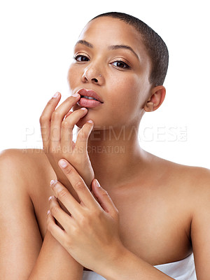 Buy stock photo Portrait of a beautiful young woman touching her lips while standing against a white background