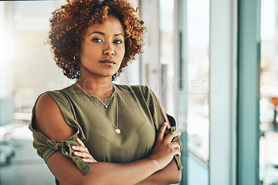 Buy stock photo Cropped portrait of an attractive mature female designer standing with her arms crossed in the office