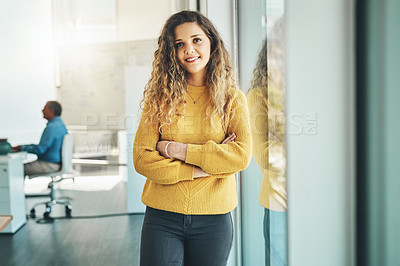 Buy stock photo Cropped portrait of an attractive young female designer standing with her arms crossed in the office