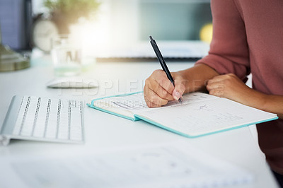 Buy stock photo Closeup shot of an unrecognizable woman writing notes in an office