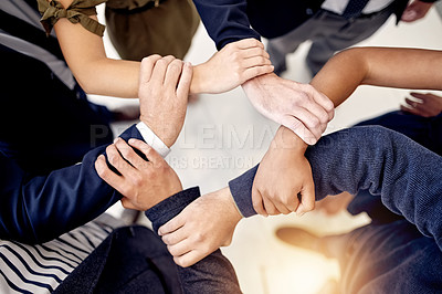Buy stock photo Closeup shot of a group of businesspeople holding on to each other's arms