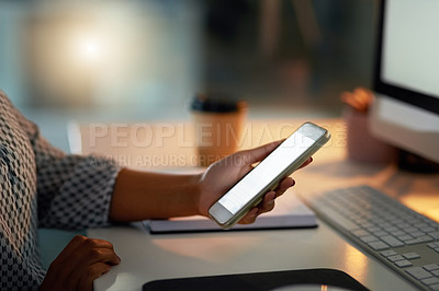 Buy stock photo Closeup shot of a businesswoman using a cellphone in an office at night