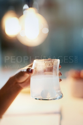 Buy stock photo Closeup shot of an unrecognizable businesswoman holding a glass of water with medication dissolved in it