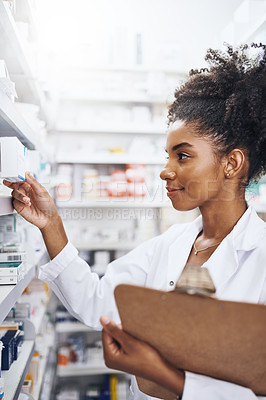 Buy stock photo Cropped shot of a female pharmacist holding a clipboard