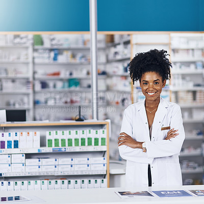 Buy stock photo Portrait of a female pharmacist standing with her arms crossed in a chemist