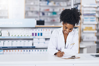 Buy stock photo Cropped shot of a confident young woman working as a pharmacist in a chemist