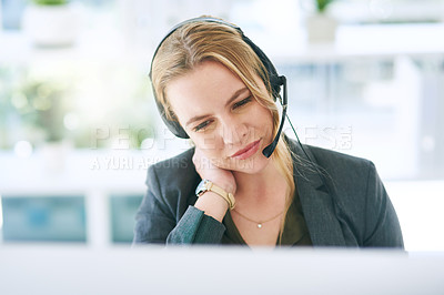 Buy stock photo Shot of a young woman working in a call centre and suffering from neck pain