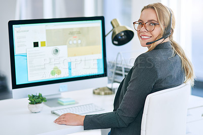 Buy stock photo Shot of a confident young woman  using a computer and headset in a modern office
