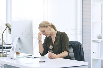 Buy stock photo Shot of a young woman working in a call centre and suffering from stress
