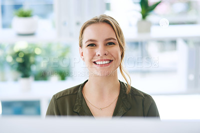 Buy stock photo Portrait of a confident young businesswoman using a computer in a modern office