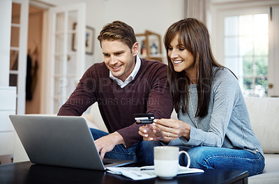 Buy stock photo Cropped shot of a couple using their card while browsing online