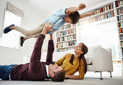 Buy stock photo Shot of a happy family spending quality time at home