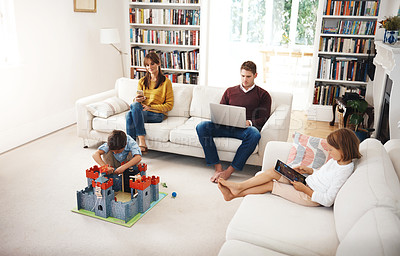 Buy stock photo Shot of a family having a relaxing day at home