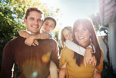 Buy stock photo Portrait of a happy family spending quality time outdoors