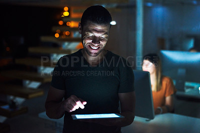 Buy stock photo Cropped shot of a handsome mature businessman working on a tablet late at night in his office