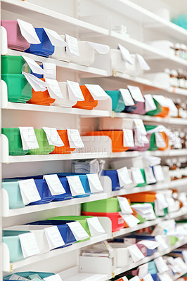 Buy stock photo Cropped shot of fully stocked shelves in an aisle of a pharmacy