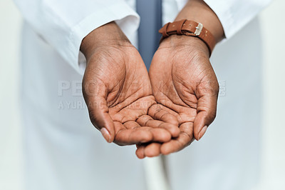 Buy stock photo High angle shot of an unrecognizable female chemist standing with her hands out while working in the pharmacy