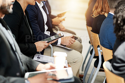 Buy stock photo Cropped shot of a group of businesspeople using digital tablets during a conference