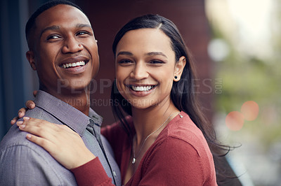 Buy stock photo Shot of a happy young couple sharing a romantic moment together