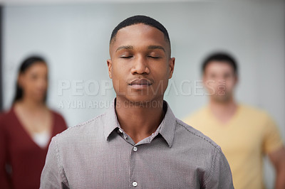 Buy stock photo Shot of a group of young businesspeople standing in a modern office with their eyes closed