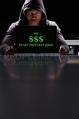 """Buy stock photo Shot of a hacker using a laptop with the words """"Pay $$$ to get your files back"""" on it"""