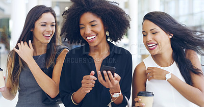 Buy stock photo Cropped shot of three young beautiful businesswomen walking through a modern office