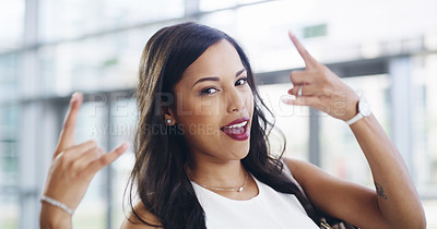 Buy stock photo Cropped shot of a young businesswoman showing a shaka hand sign while walking through a modern office