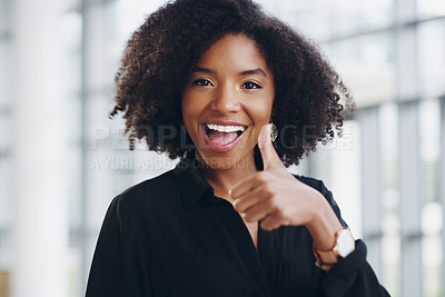 Buy stock photo Cropped shot of a young businesswoman showing thumbs up while walking through a modern office