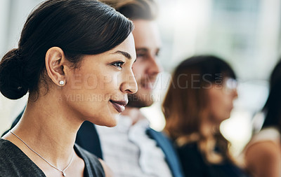 Buy stock photo Shot of a group of businesspeople sitting in the conference room during a seminar