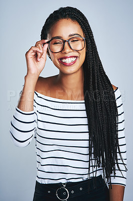 Buy stock photo Cropped shot of a happy young woman posing against a grey background