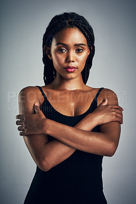 Buy stock photo Shot of a beautiful young woman posing against a grey background
