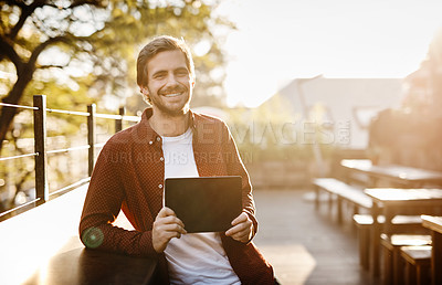 Buy stock photo Cropped portrait of a handsome young man showing you the screen of his digital tablet outside