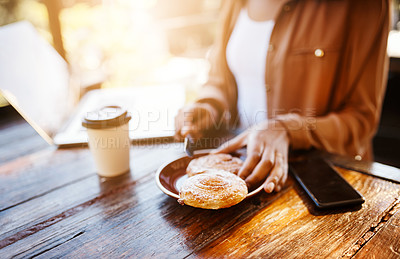 Buy stock photo Cropped shot of an unrecognizable female customer sitting in a coffee shop