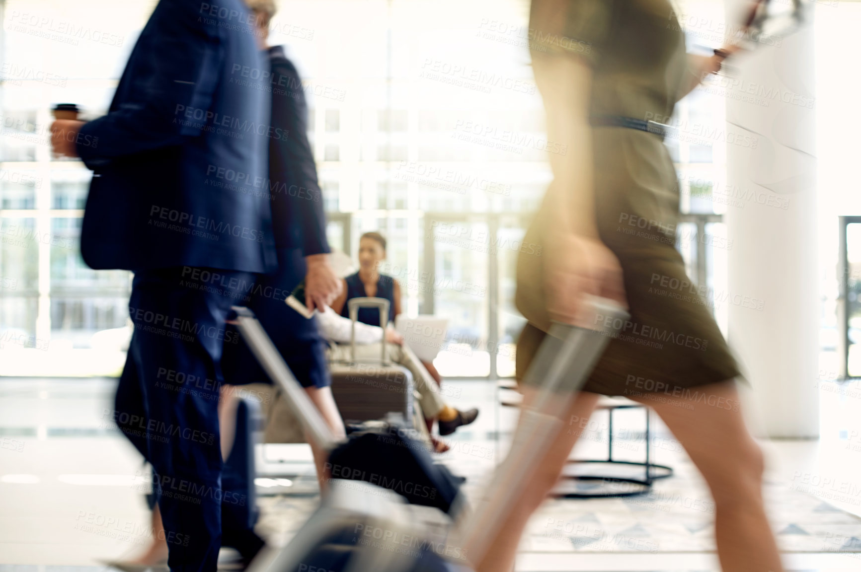 Buy stock photo Shot of businesspeople walking around inside of a busy airport during the day